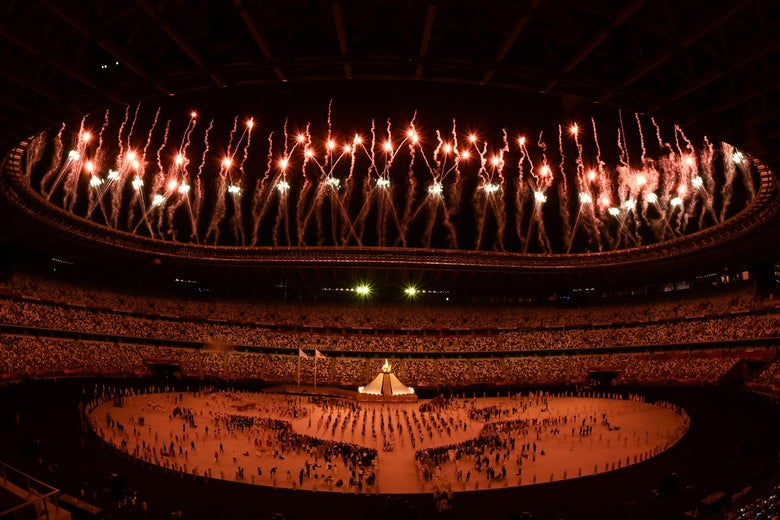 Fireworks go off around the Olympic Stadium after the lighting of the Olympic Flame during the opening ceremony of the Tokyo 2020 Olympic Games, in Tokyo, on July 23, 2021. (Photo by Jewel SAMAD / AFP) (Photo by JEWEL SAMAD/AFP via Getty Images)