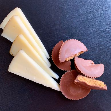 Slices of manchego with pieces of Reese's Peanut Butter Cups