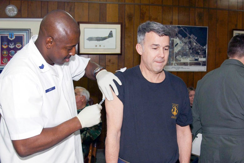 A man gets vaccinated by a health care worker.