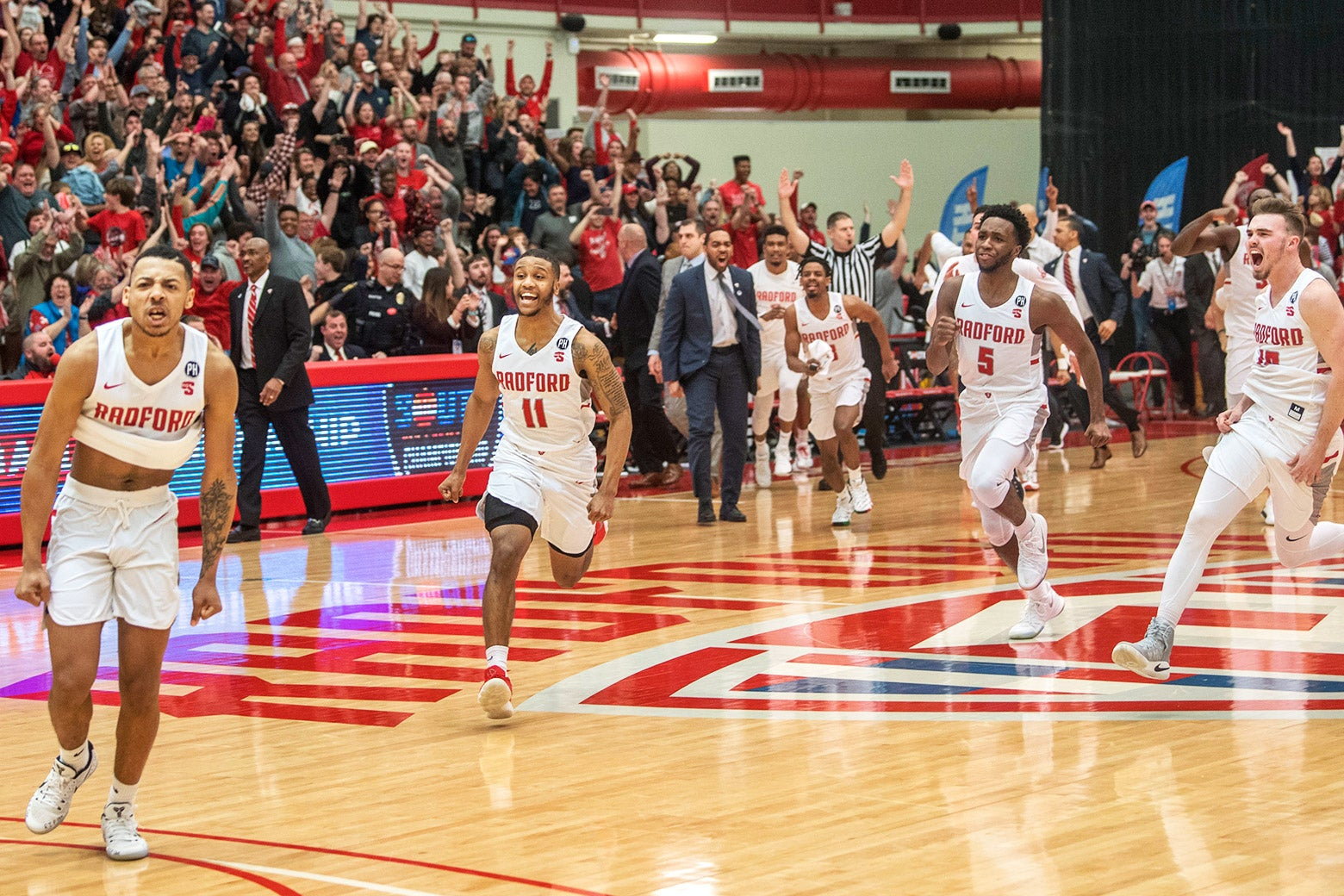Radford guard Carlik Jones, left, celebrates after sinking a three-point basket to win as teammates Travis Fields Jr. (11), Donald Hicks (5) and Caleb Tanner, right, also celebrate after the Big South Conference championship NCAA college basketball game against Liberty on Sunday, Mar. 4, 2018.