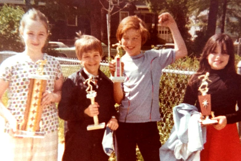 The author, far right, holding a candlepin bowling trophy, like everyone else.