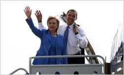 Democratic presidential candidate Sen. Barack Obama (D-IL) and Sen. Hillary Rodham Clinton (D-NY) wave while boarding Obama's campaign plane. Click image to expand.