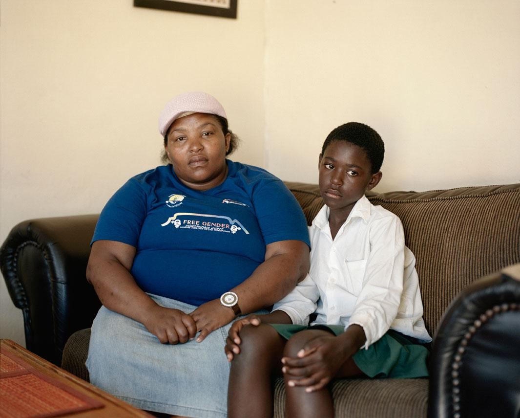 "Nono Ntshangan, Nyanga, Cape Town After Nono Ntshangan's cousin discovered she was a lesbian, he raped her each time he saw her. She had his daughter in 2000. ""He never approved of me being a lesbian, he always wanted me to be a girl.""After the last incident Nono went to the hospital and discovered she was pregnant. ""I told my Aunt what had happened and my family dismissed it.  They never approved of me being a lesbian, they always wanted me to be a girl."""