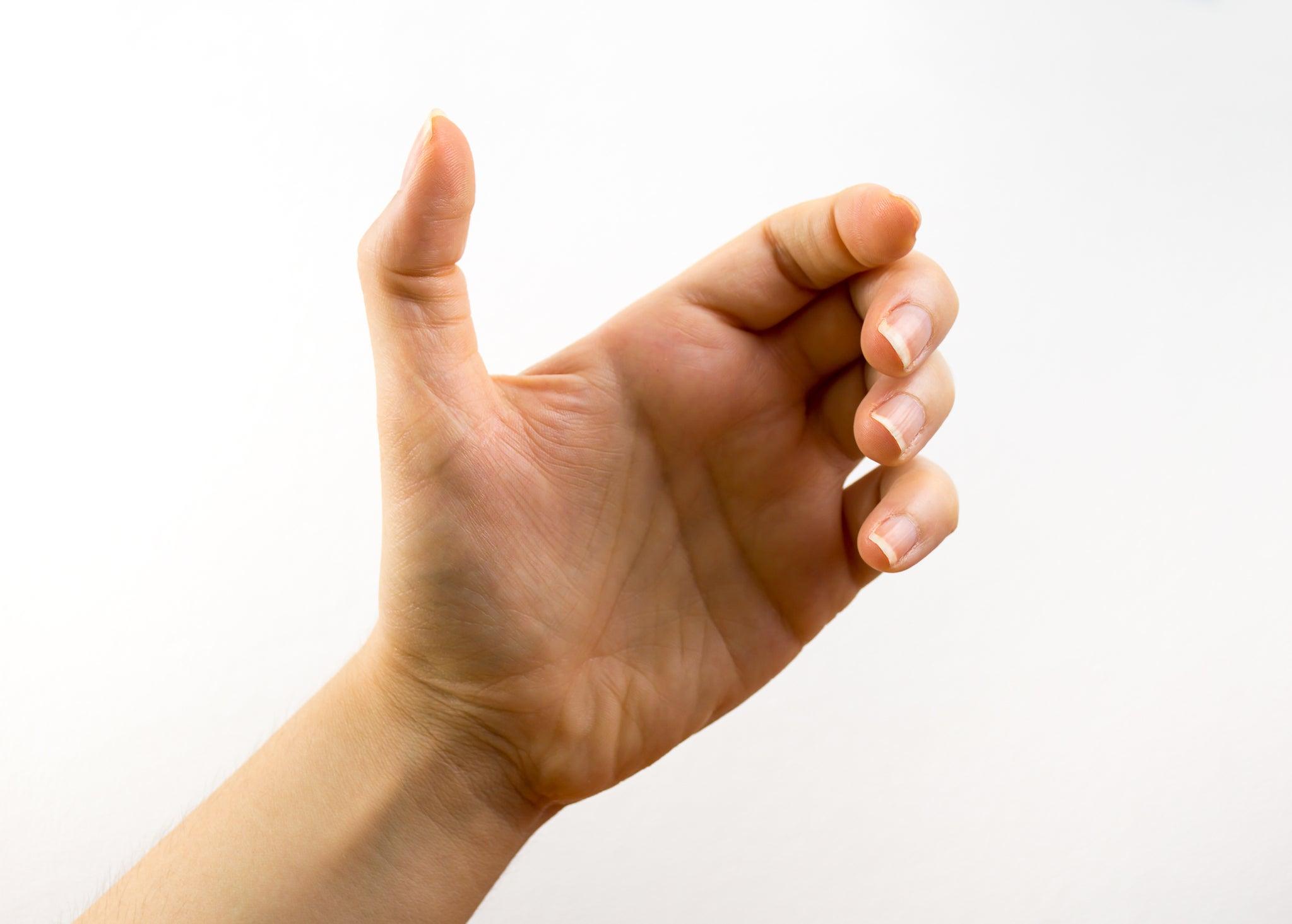 An empty hand cradles an imaginary cellphone.