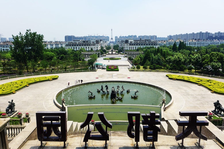 Overlooking Hangzhou's Sky City, with views of its parterre gardens, many fountains, and iconic Eiffel Tower.