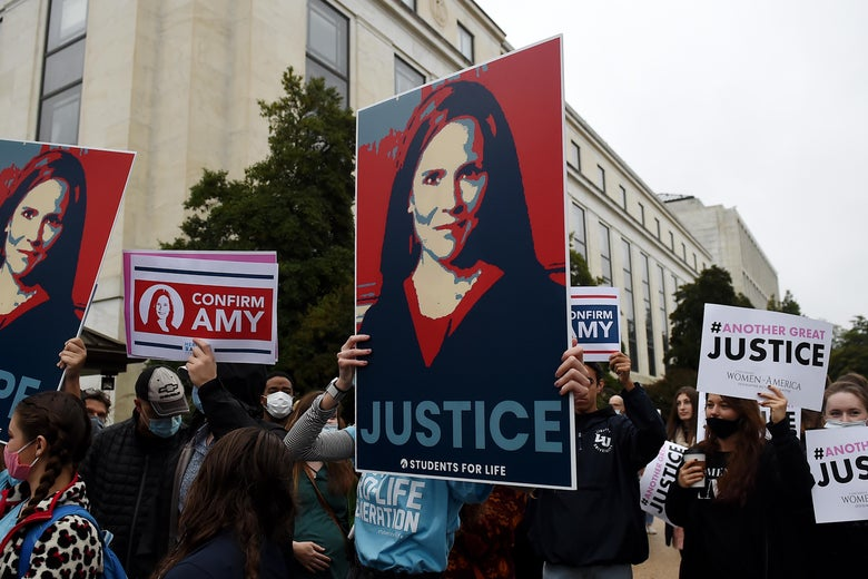 Supporters of President Donald Trump's Supreme Court nominee Amy Coney Barrett gather on Capitol Hill on the first day of her nomination hearing on October 12, 2020 in Washington, D.C.