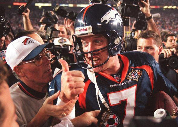 John Elway gives a thumbs up after the Broncos defeated the Green Bay Packers 31-24 to win Super Bowl XXXII.