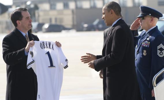 Scott Walker hands Obama a Brewers jersey.