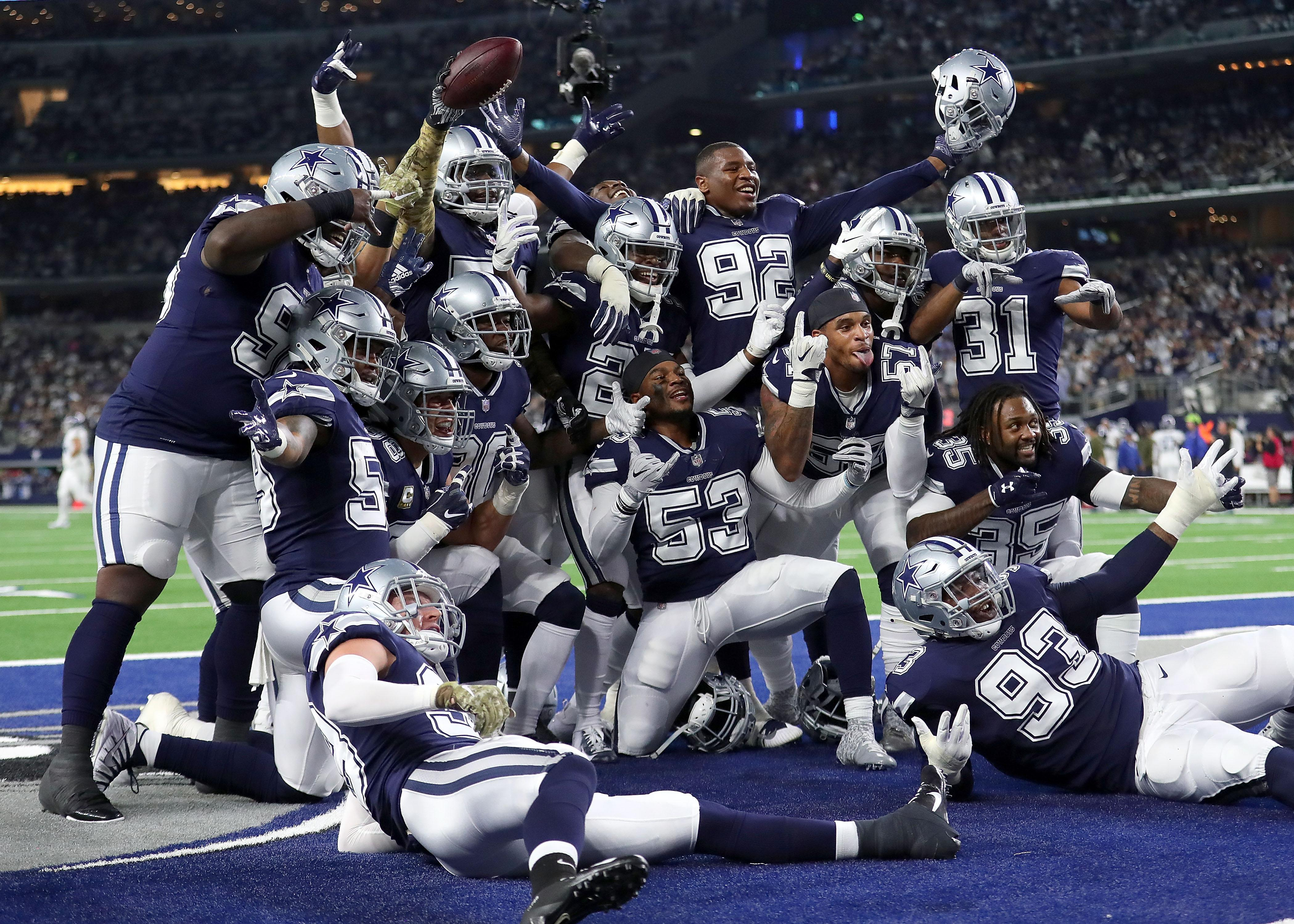 ARLINGTON, TX - NOVEMBER 05:  The Dallas Cowboys defensive line poses for a photo in the end zone after a fumble recovery against the Tennessee Titans in the first quarter of a football game at AT&T Stadium on November 5, 2018 in Arlington, Texas. (Photo by Tom Pennington/Getty Images)