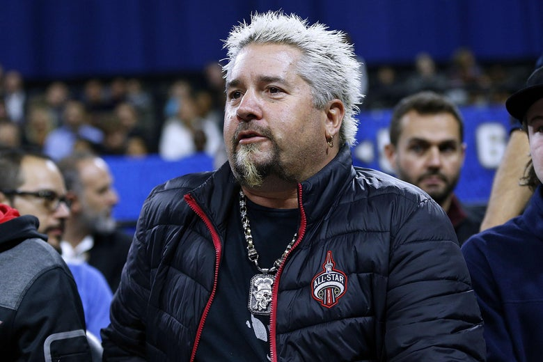NEW ORLEANS, LA - FEBRUARY 17: Guy Fieri reacts during the NBA All-Star Celebrity Game at the Mercedes-Benz Superdome on February 17, 2017 in New Orleans, Louisiana. NOTE TO USER: User expressly acknowledges and agrees that, by downloading and or using this photograph, User is consenting to the terms and conditions of the Getty Images License Agreement.  (Photo by Jonathan Bachman/Getty Images)
