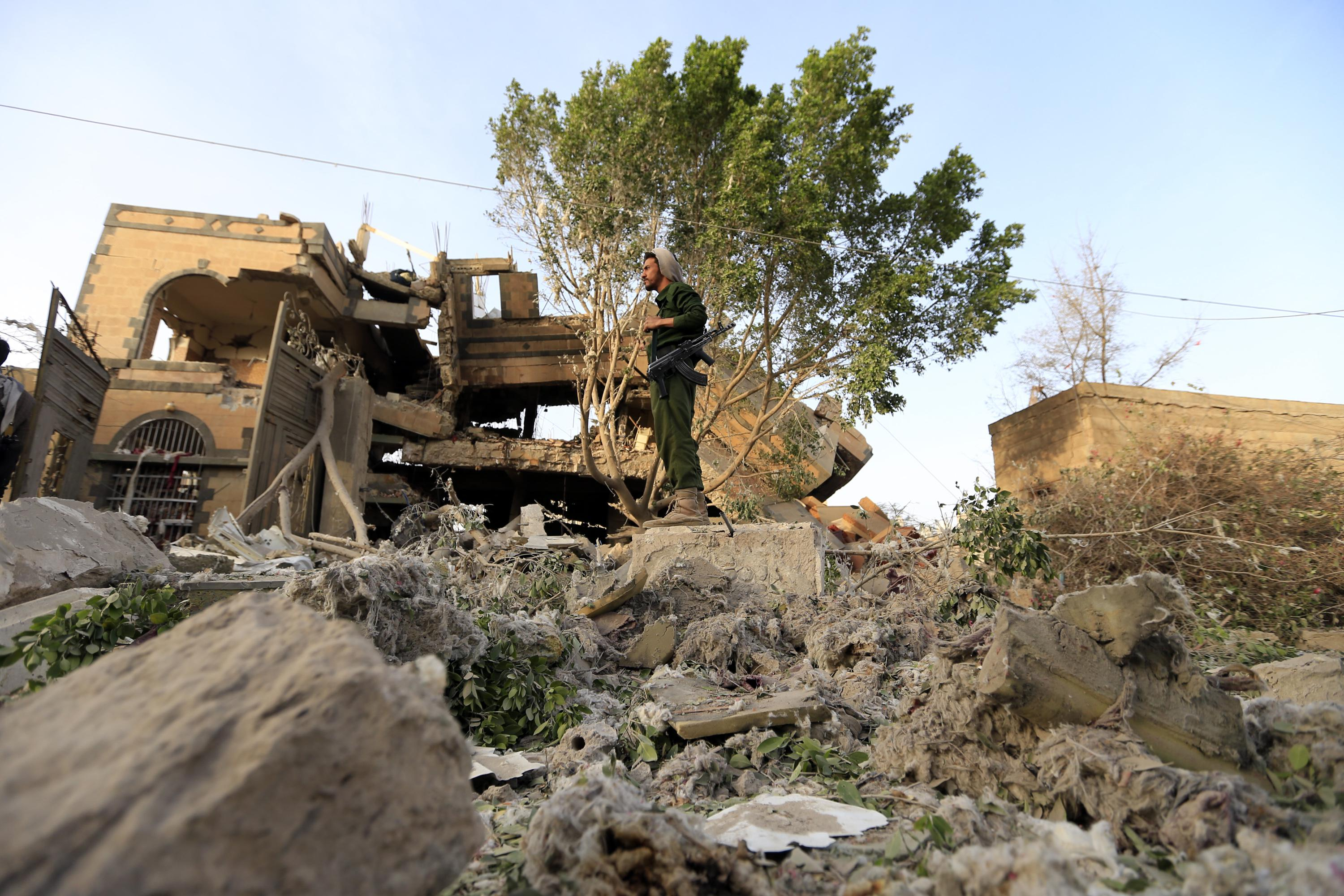 A Yemeni soldier stands in the rubble of a destroyed house in the aftermath of a reported air strike by the Saudi-led coalition in a neighbourhood in the Yemeni capital Sanaa on June 6, 2018. - According to media reports, at least nine Yemenis, including two women, were injured. (Photo by MOHAMMED HUWAIS / AFP)        (Photo credit should read MOHAMMED HUWAIS/AFP/Getty Images)