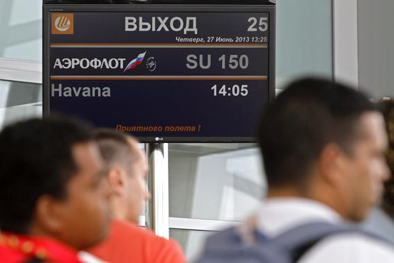 People wait before boarding an Aeroflot Airbus A330 plane heading to the Cuban capital Havana at Moscow's Sheremetyevo airport June 27, 2013.
