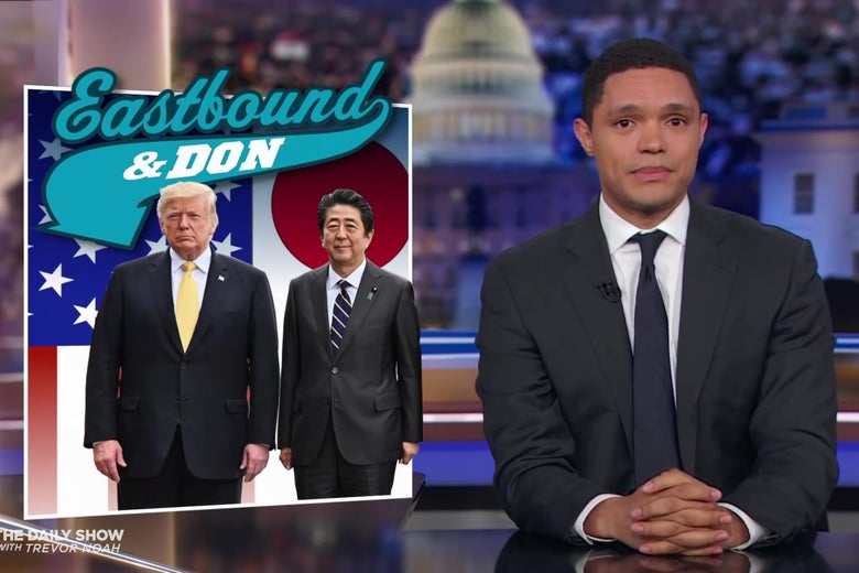 "Trevor Noah in front of a photo of Trump and Shinzō Abe, captioned ""Eastbound and Don."""