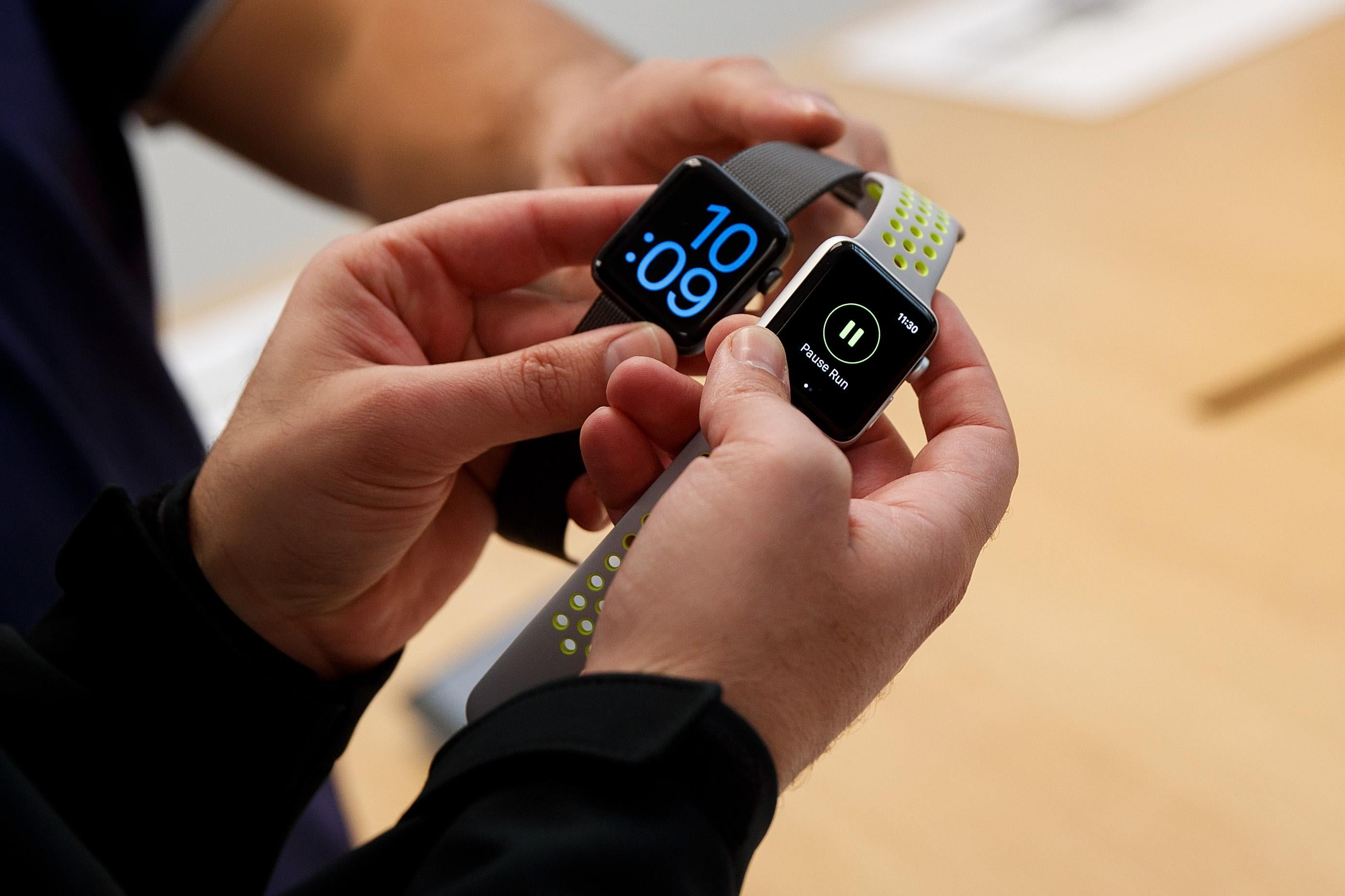 A customer looks at Apple Watch Nike+ at an Apple Store in the SoHo neighborhood of Manhattan, October 28, 2016 in New York City.