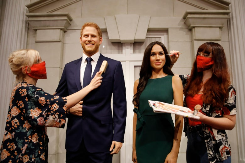 Artists put the finishing touches to wax figures of Britain's Prince Harry, Duke of Sussex and Britain's Meghan, Duchess of Sussex as Madame Tussauds prepares to reopen its doors to the public on July 30, 2020 following the easing of coronavirus lockdown restrictions in England. (Photo by Tolga AKMEN / AFP) (Photo by TOLGA AKMEN/AFP via Getty Images)