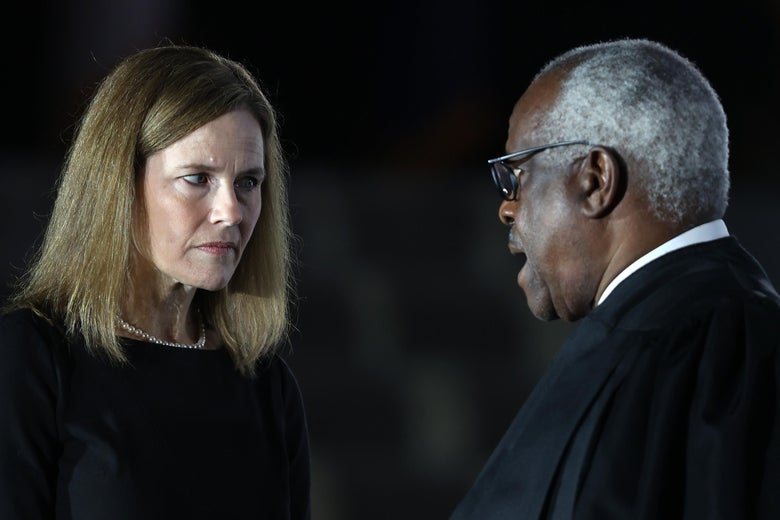 Judge Amy Coney Barrett talks with Supreme Court Associate Justice Clarence Thomas during her ceremonial swearing-in ceremony to be U.S. Supreme Court Associate Justice, on the South Lawn of the White House October 26, 2020 in Washington,