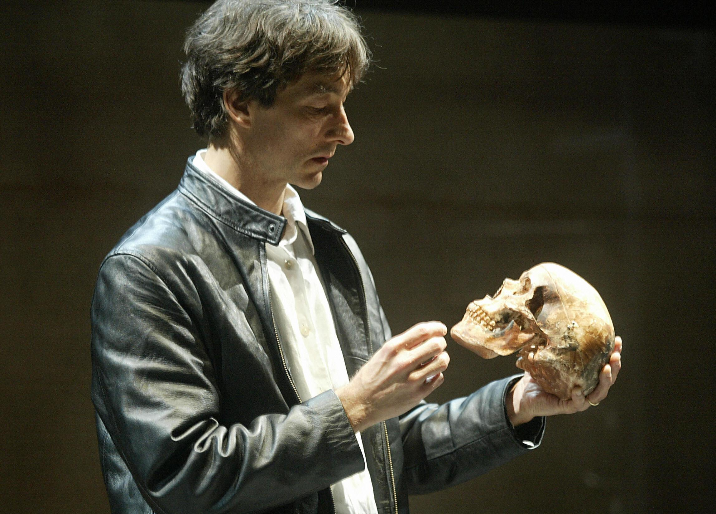 Jonathan Douglas holds a skull as he portrays a futuristic Hamlet at the Shouson theatre in Hong Kong.