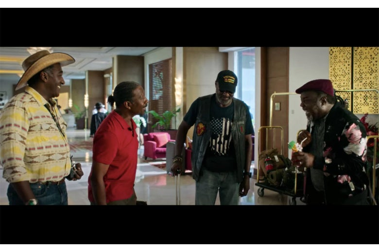 A scene from Da 5 Bloods showing four men at an airport