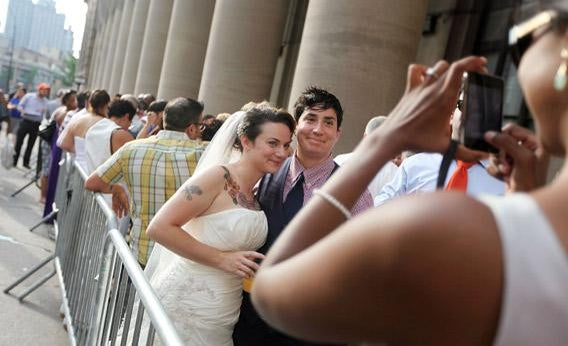 photographed waiting on line to get married at the Brooklyn.