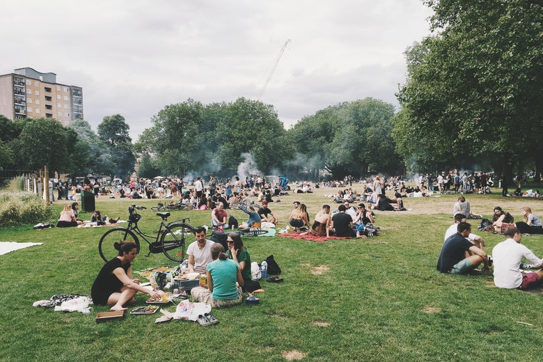 People picnicking in an urban park.