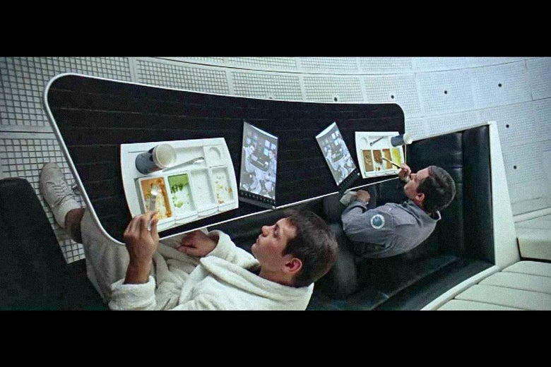 Characters watch a news segment about their mission on iPad-like screens in 2001: A Space Odyssey.