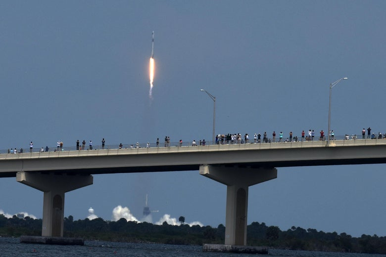 People line the A.Max Brewer Causeway to watch the launch of a SpaceX Falcon 9 rocket from Cape Canaveral, Florida May 30, 2020 in Titusville, Florida.