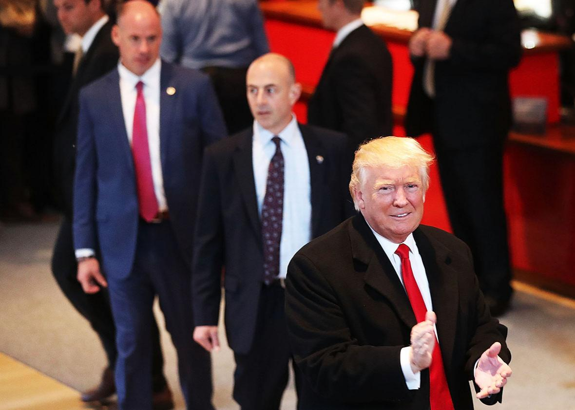 President-elect Donald Trump walks through the lobby of the New York Times following a meeting with editors at the paper on November 22, 2016 in New York City.
