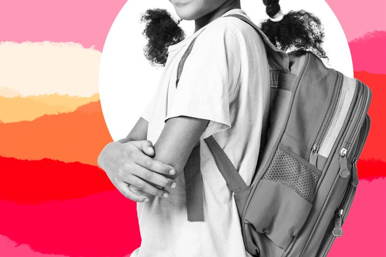 A girl wears a backpack.