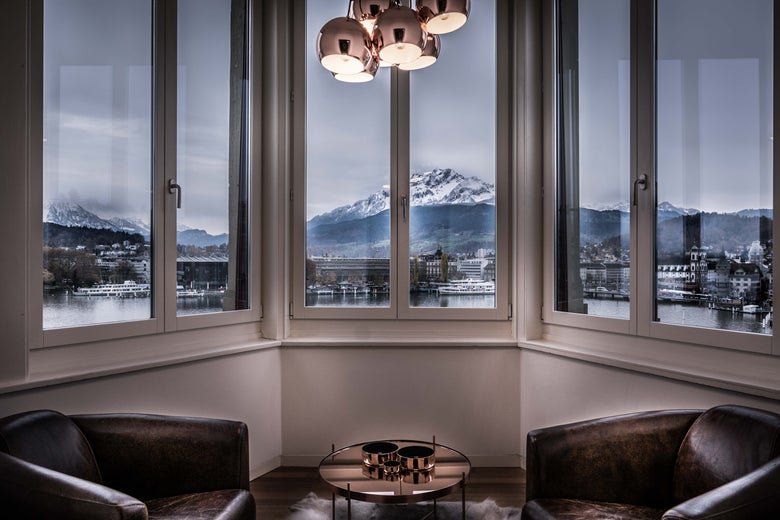 A mountain view from the window of a luxury apartment.