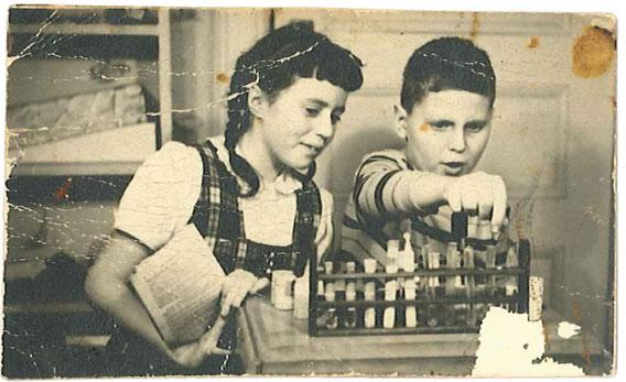 Paul Plotz and his sister Liz with his chemistry set, probably in 1948.