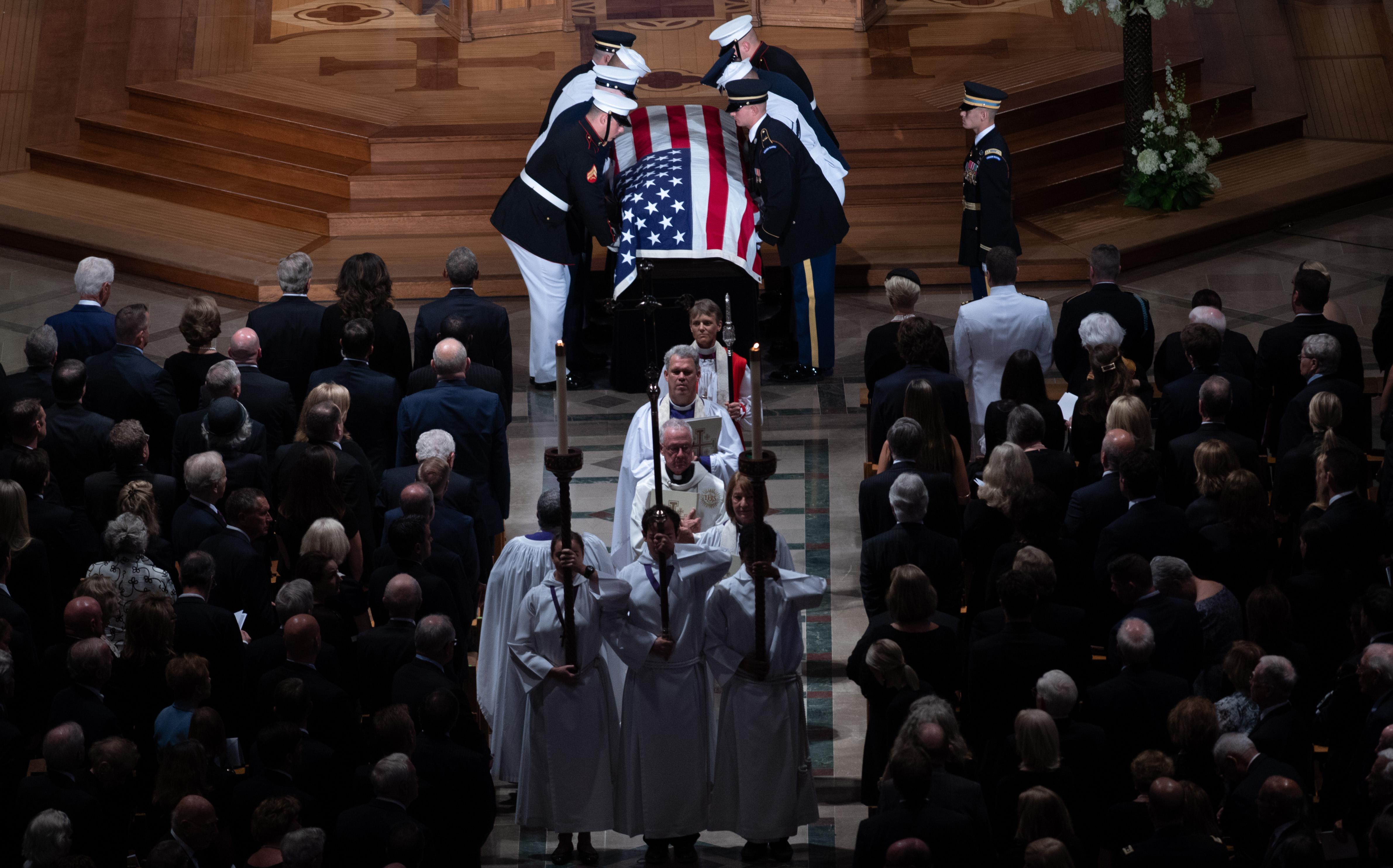 The casket of John McCain, carried out by a Military Honor Guard.