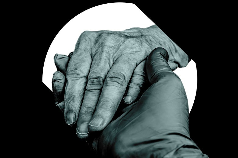 A gloved hand holding an older patient's hand