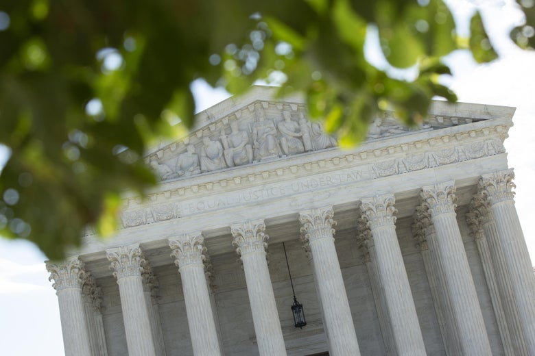 WASHINGTON, DC - JUNE 30: A general view of the U.S. Supreme Court on June 30, 2020, at an angle, with leaves in front.