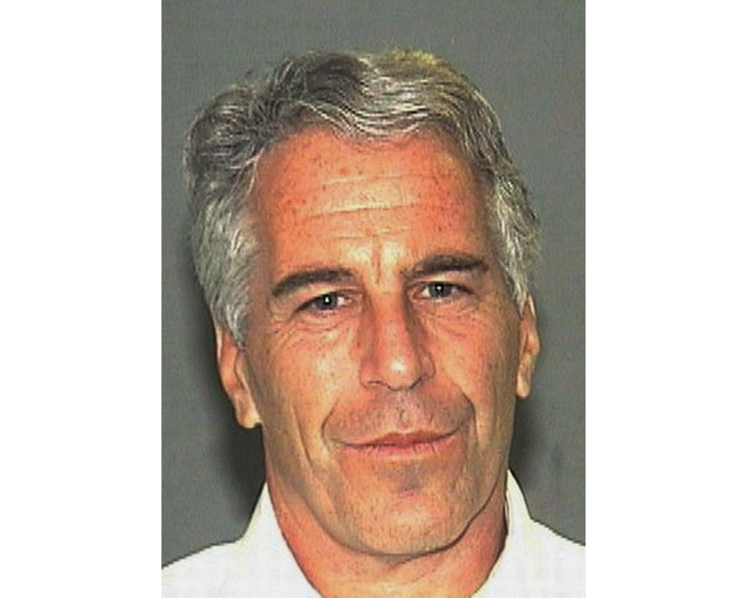 A file photo of Epstein, close-up, lightly smiling
