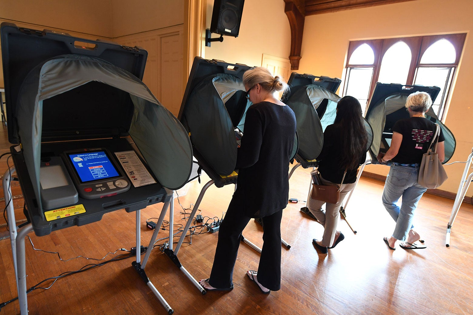 People use electronic voting machines to cast their ballots.