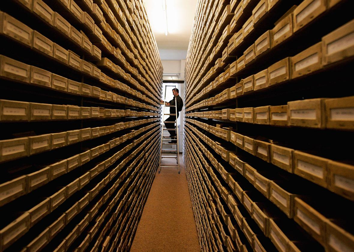 An employee of the ITS (International Tracing Service) researches documents at the Holocaust Archive on April 28, 2006 in Bad Arolsen, Germany.