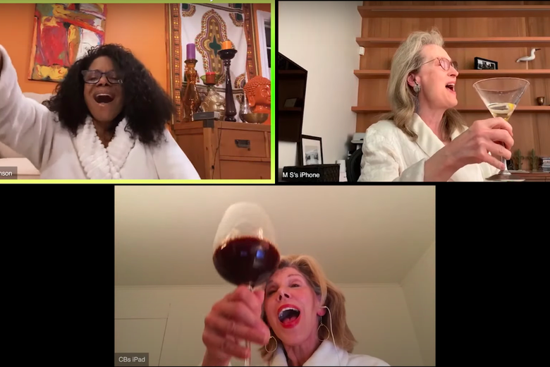 Audra McDonald, Meryl Streep, and Christine Baranski on three separate video chat screens, wearing bathrobes and holding up glasses of alcohol while singing