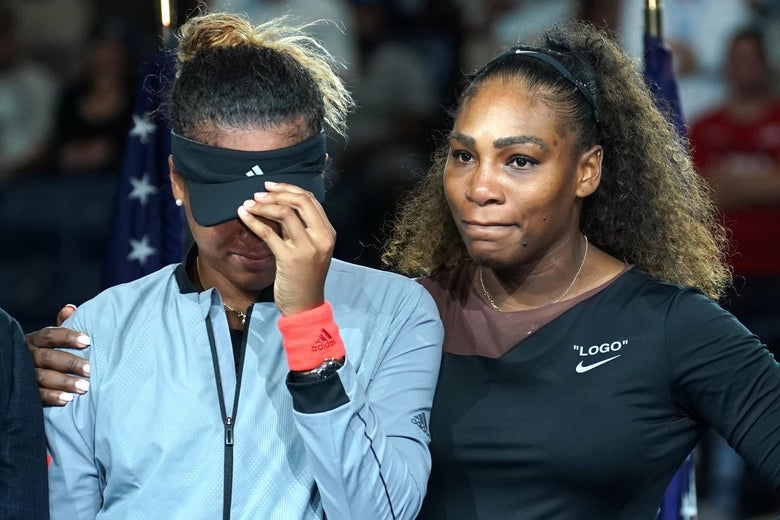 The victor Naomi Osaka of Japan (L) stands beside the defeated Serena Williams of the US following their Women's Singles Finals match at the 2018 US Open at the USTA Billie Jean King National Tennis Center in New York on September 8, 2018. - Osaka, 20, triumphed 6-2, 6-4 in the match marred by Williams's second set outburst, the American enraged by umpire Carlos Ramos's warning for receiving coaching from her box. She tearfully accused him of being a 'thief' and demanded an apology from the official. (Photo by TIMOTHY A. CLARY / AFP)        (Photo credit should read TIMOTHY A. CLARY/AFP/Getty Images)