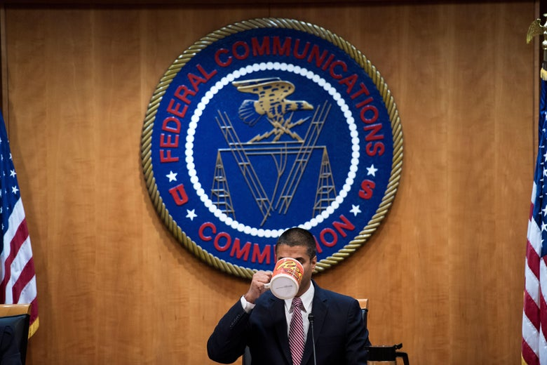 Ajit Pai sips from a giant Reese's mug beneath the seal of the FCC.