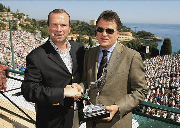 Journalist Neil Harman of the Times of London receives the Roy Bookman media award from Etienne de Villiers, then-chairman of the ATP Tour, during the Monte-Carlo Rolex Masters on April 22, 2006, in Monaco.