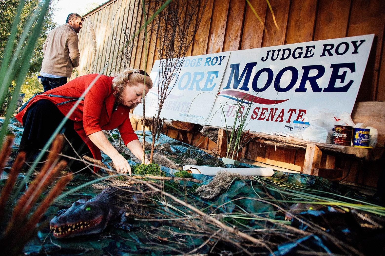 Janet Porter decorates a fake swamp in Alabama.