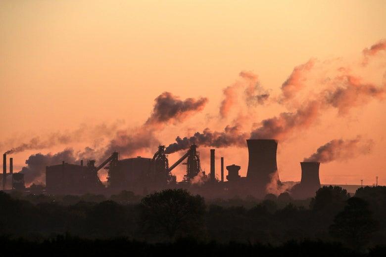 A power plant belches smoke.
