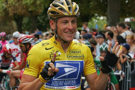 Lance Armstrong riding for the U.S. Postal Service team shows six fingers representing his six consecutive Tour de France victories