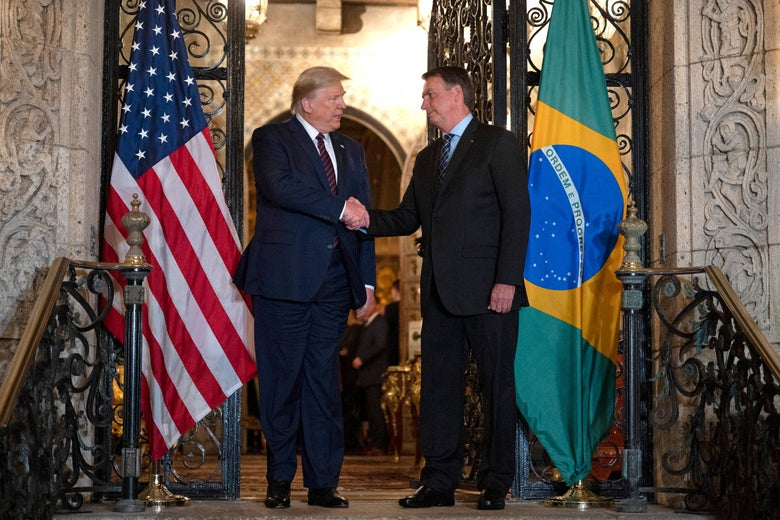 President Trump shakes hands with Brazilian President Jair Bolsonaro earlier this month at Mar-a-Lago.