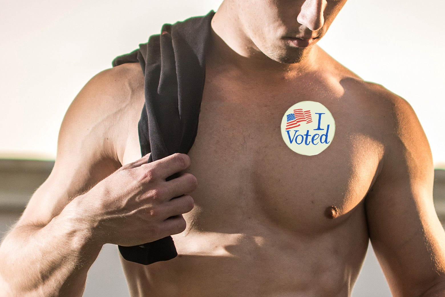 "Shirtless man with ""I Voted"" sticker."