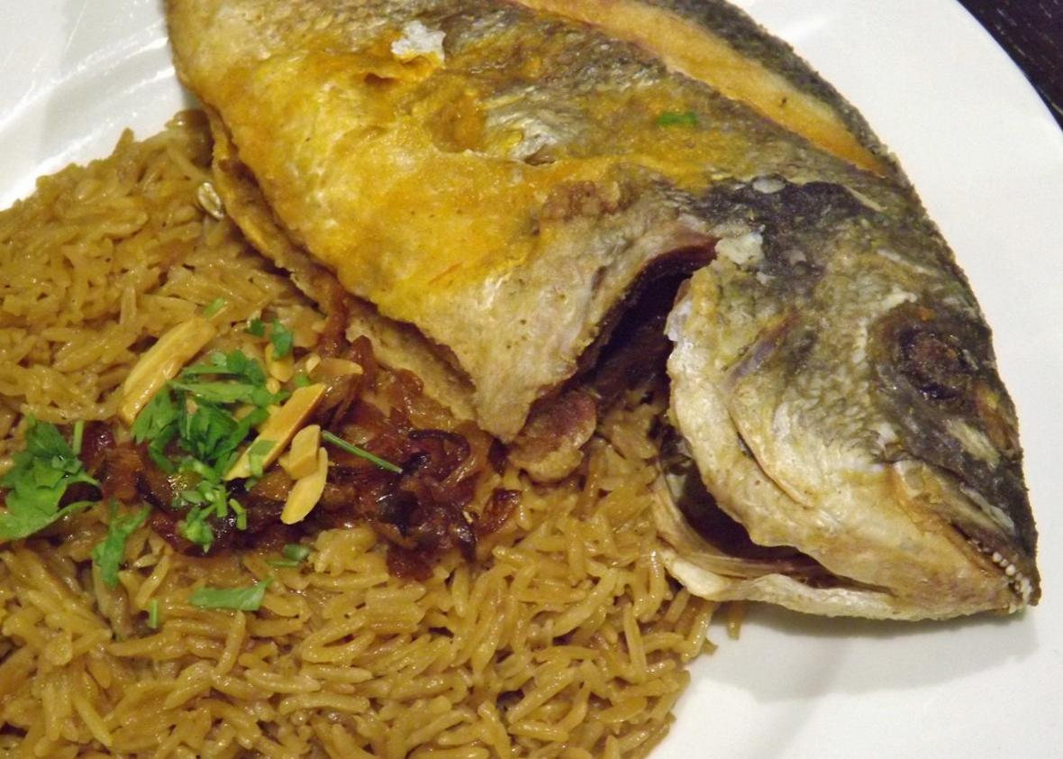 Sayadieh, a Syrian fish dish with spiced rice and caramelized onions.