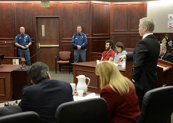 The prosecution team at their table during the proceedings where District Court Judge William Sylvester entered a Not Guilty plea on behalf of Aurora theater shooting suspect James Holmes