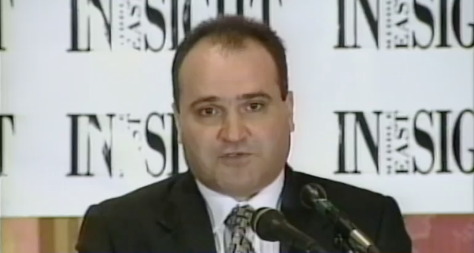 A screen grab from C-Span shows George Nader speaking at an event discussing Iran's regional policies on June 17, 1998.