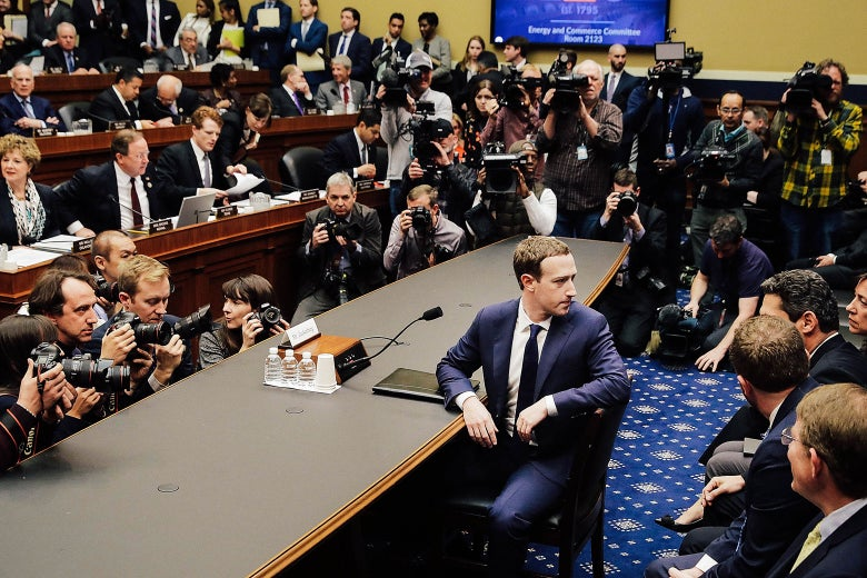 Mark Zuckerberg turns to face the gallery before testifying on Capitol Hill on April 11.