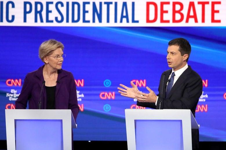 Buttigieg gestures towards Warren while speaking.